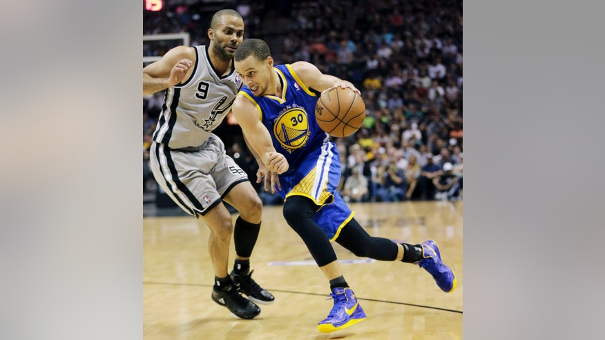 Golden State Warriors' Stephen Curry (30) drives on San Antonio Spurs' Tony Parker (9), of France, defends during the second half in Game 5 of a Western Conference semifinal NBA basketball playoff series, Tuesday, May 14, 2013, in San Antonio. (AP Photo/Eric Gay)