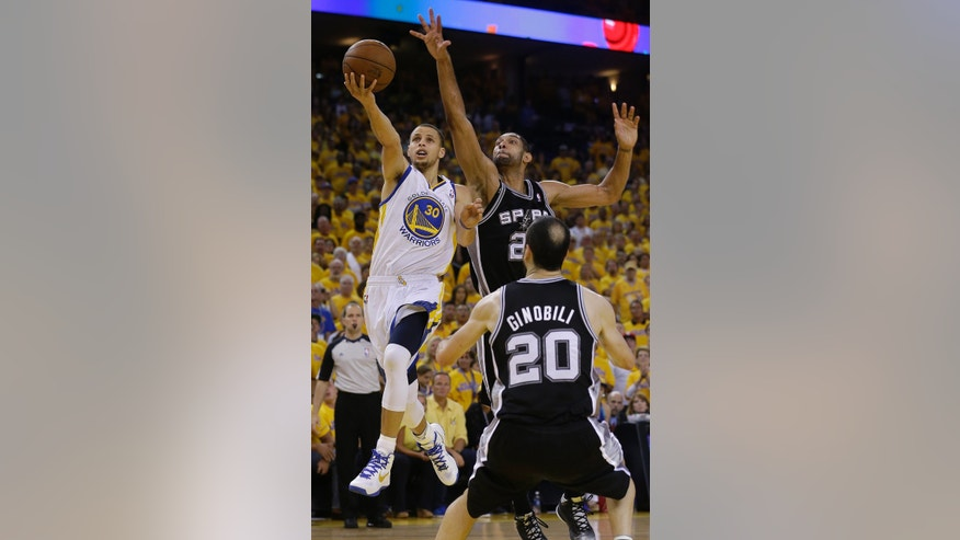 Golden State Warriors guard Stephen Curry (30) shoots against San Antonio Spurs forward Tim Duncan and guard Manu Ginobili (20), of Argentina, during overtime of Game 4 of a Western Conference semifinal NBA basketball playoff series in Oakland, Calif., Sunday, May 12, 2013. The Warriors won 97-87 in overtime. (AP Photo/Jeff Chiu)