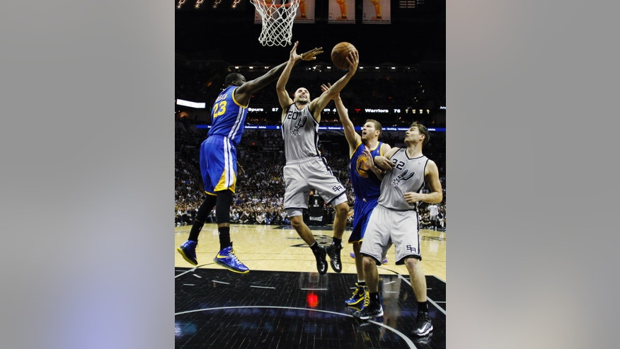 San Antonio Spurs' Manu Ginobili (20), of Argentina, shoots as Golden State Warriors' Draymond Green (23) and David Leeduring (10) defend him the second half in Game 5 of a Western Conference semifinal NBA basketball playoff series, Tuesday, May 14, 2013, in San Antonio. San Antonio Spurs' Tiago Splitter (22), of Brazil, assists on the play. (AP Photo/Eric Gay)
