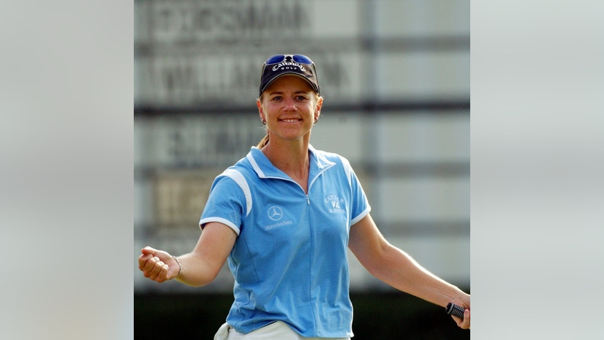 ADVANCE FOR WEEKEND EDITIONS, MAY 18-19 - FILE - In this May 23, 2003, file photo, Annika Sorenstam acknowledges the gallery after completing the 18th hole of the second round of the Colonial golf tournament at the Colonial Country Club in Fort Worth, Texas.  Sorenstam's historic ride at the Colonial ended  when she stumbled to five bogeys in a span of eight holes and missed the cut by four shots. (AP Photo/Dave Martin, File)