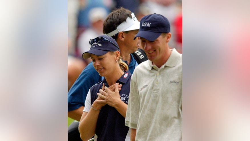 ADVANCE FOR WEEKEND EDITIONS, MAT 18-19 - FILE - In this May 22, 2003, file photo, golfer Annika Sorenstam holds her heart as she walks off the 13th green with playing partner Aaron Barber, right, and her caddie Terry McNamara after making a birdie during the first round of the Colonial golf tournament at the Colonial Country Club in Fort Worth, Texas..  Sorenstam's historic ride at the Colonial ended when she stumbled to five bogeys in a span of eight holes and missed the cut by four shots. (AP Photo/David J. Phillip, File)