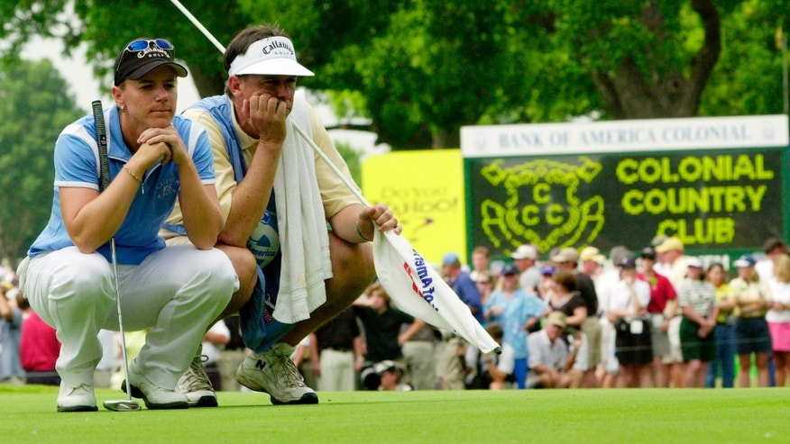 ADVANCE FOR WEEKEND EDITIONS, MAT 18-19 - FILE - In this May 23, 2003, file photo, golfer Annika Sorenstam and her caddie Terry McNamara wear long faces as they wait for Sorenstam's turn to putt on the 10th hole during the second round of the Colonial golf tournament at the Colonial Country Club in Fort Worth, Texas.  Sorenstam's historic ride at the Colonial ended  when she stumbled to five bogeys in a span of eight holes and missed the cut by four shots.(AP Photo/David J. Phillip, File)