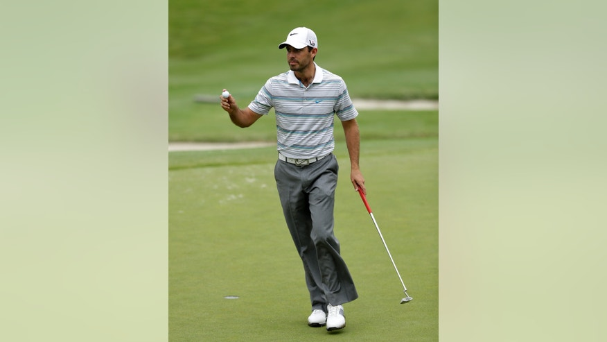 Charl Schwartzel, of South Africa,  acknowledges applause from the gallery after sinking a birdie putt on the fourth green during the first round of the Byron Nelson Championship golf tournament Thursday, May 16, 2013, in Irving, Texas. Schwartzel finished the round at 7-under par 63. (AP Photo/Tony Gutierrez)