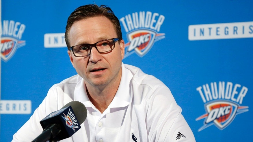 Oklahoma City Thunder head coach Scott Brooks answers a question during a news conference in Oklahoma City, Thursday, May 16, 2013. Torpedoed by an injury to All-Star point guard Russell Westbrook, the Thunder's season is over far sooner than expected. After making it to the NBA Finals last season, Oklahoma City couldn't make it out of the second round this year with Westbrook sidelined. (AP Photo/Sue Ogrocki)
