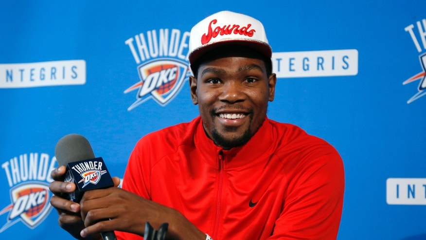 Oklahoma City Thunder forward Kevin Durant smiles during an NBA basketball news conference in Oklahoma City, Thursday, May 16, 2013. Torpedoed by an injury to All-Star point guard Russell Westbrook, the Thunder's season is over far sooner than expected. After making it to the NBA Finals last season, Oklahoma City couldn't make it out of the second round this year with Westbrook sidelined.(AP Photo/Sue Ogrocki)
