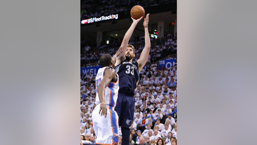 Memphis Grizzlies Marc Gasol shoots as Oklahoma City Thunder's Kevin Durant defends during the second half of Game 5 of their Western Conference Semifinals NBA basketball playoff series in Oklahoma City, Wednesday, May 15, 2013. Memphis won 88-84. (AP Photo/Alonzo Adams)