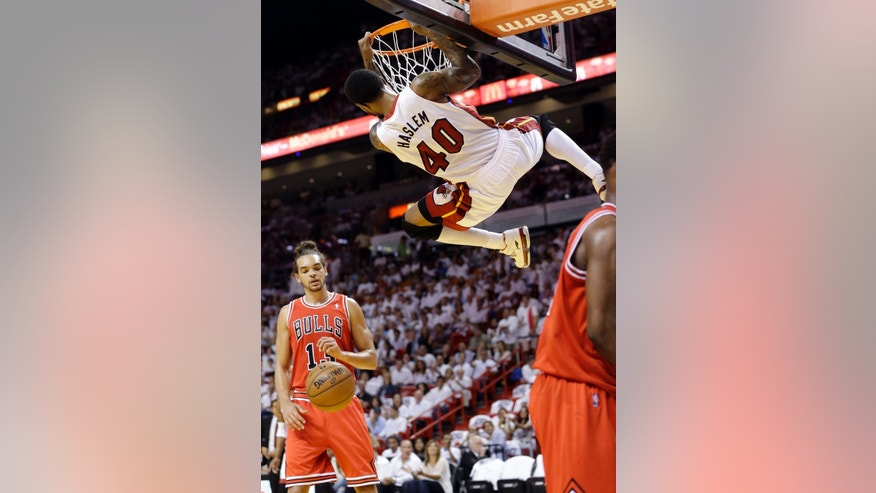 Miami Heat's Udonis Haslem (40) dunks in front of Chicago Bulls' Joakim Noah (13) during the first half of Game 5 of an NBA basketball Eastern Conference semifinal, Wednesday, May 15, 2013, in Miami. (AP Photo/Wilfredo Lee)