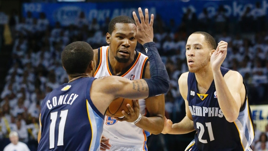 Oklahoma City Thunder forward Kevin Durant (35) is fouled by Memphis Grizzlies guard Mike Conley (11) as he drives between Conley and forward Tayshaun Prince (21) in the second half of Game 5 of their Western Conference Semifinals NBA basketball playoff series in Oklahoma City, Wednesday, May 15, 2013. Memphis won 88-84. (AP Photo/Sue Ogrocki)