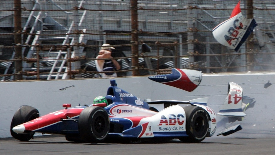 The car driven by Conor Daly hits the wall in the first during practice for the Indianapolis 500 auto race at the Indianapolis Motor Speedway in Indianapolis, Thursday, May 16, 2013. Daly was not injured. (AP Photo/Joe Watts)