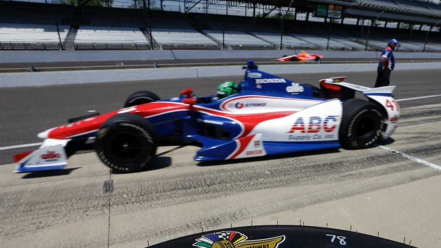 Conor Daly pulls out of the pit area during practice for the Indianapolis 500 auto race at the Indianapolis Motor Speedway in Indianapolis, Wednesday, May 15, 2013. (AP Photo/Darron Cummings)