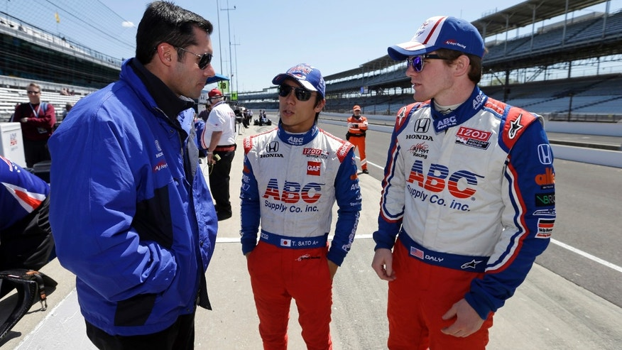 Team director Larry Foyt, left, talks with drivers Takuma Sato, of Japan, center, and Conor Daly during practice for the Indianapolis 500 auto race at the Indianapolis Motor Speedway in Indianapolis, Monday, May 13, 2013. (AP Photo/Darron Cummings)