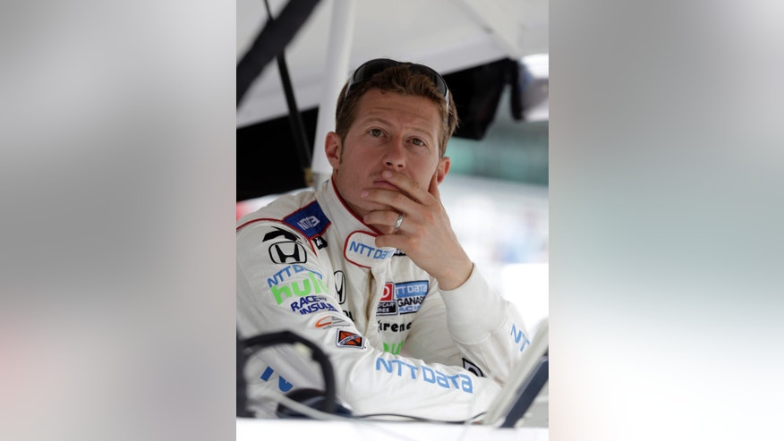 Ryan Briscoe, of Australia, checks the scoring monitors as he waits to practice for the Indianapolis 500 auto race at the Indianapolis Motor Speedway in Indianapolis, Thursday, May 16, 2013. (AP Photo/Darron Cummings)