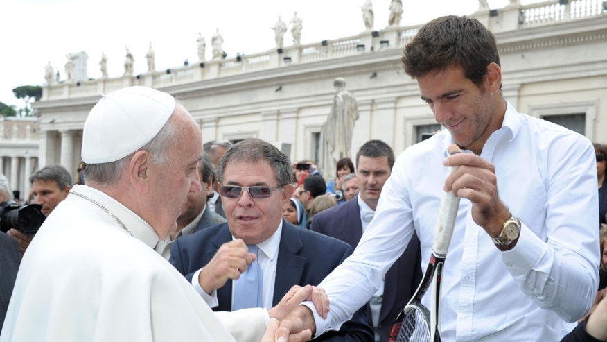 In this photo provided Thursday, May 16, 2013 by the Vatican newspaper l'Osservatore Romano, Pope Francis is greeted by Argentine tennis player Juan Martin del Potro, who gave him his tennis racket, at the end of the pontiff's general audience in St. Peter's Square at the Vatican, Wednesday, May 15, 2013. (AP Photo/L'Osservatore Romano, ho)