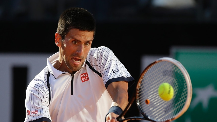 Serbia's Novak Djokovic returns the ball to Spain's Albert Montanes during their match at the Italian Open tennis tournament in Rome, Tuesday, May 14, 2013. Djokovic won 6-2, 6-3. (AP Photo/Gregorio Borgia)