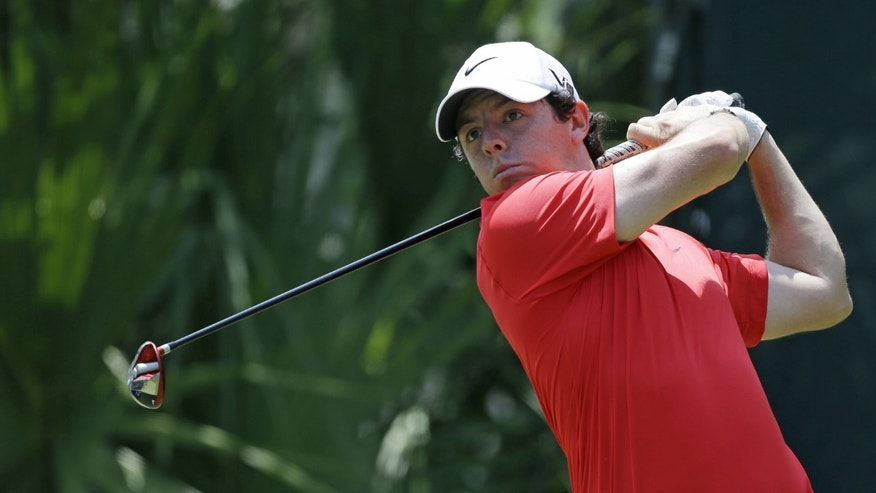 Rory McIlroy, of Northern Ireland, hits from the fifth tee during the third round of The Players championship golf tournament at TPC Sawgrass, Saturday, May 11, 2013, in Ponte Vedra Beach, Fla. (AP Photo/John Raoux)