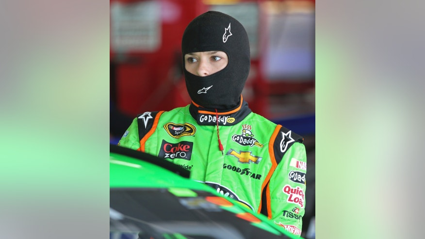 Danica Patrick climbs into her race car before practice for the NASCAR Sprint Showdown auto race at Charlotte Motor Speedway in Concord, N.C., Friday, May 17, 2013. (AP Photo/Bob Jordan)