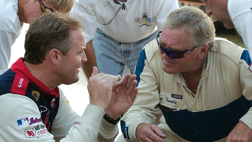 In this July 13, 2005, photo, Kenny Wallace, left, and Dick Trickle discuss track conditions at the Slinger Nationals auto race in Slinger, Wis. Trickle, whose larger-than-life personality and penchant for fun won him legions of fans despite a lack of success beyond the nation's small tracks, died Thursday, May 16, 2013, of an apparent self-inflicted gunshot wound, authorities said. He was 71. (AP Photo/West Bend Daily News)