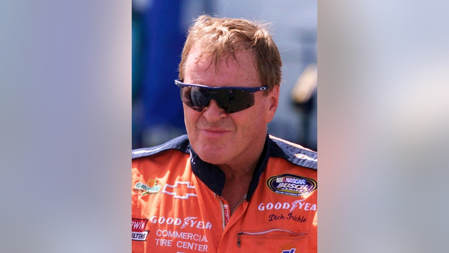 FILE - In this June 4, 1999, file photo, NASCAR driver Dick Trickle speaks to fans after qualifying on the pole position the NASCAR Busch series auto race at Dover Downs in Dover, Del. Authorities in North Carolina said Thursday, May 16, 2013, that Trickle has died of an apparent self-inflicted gunshot wound. He was 71.  (AP Photo/The News Journal, Brian Branch-Price, File) NO SALES