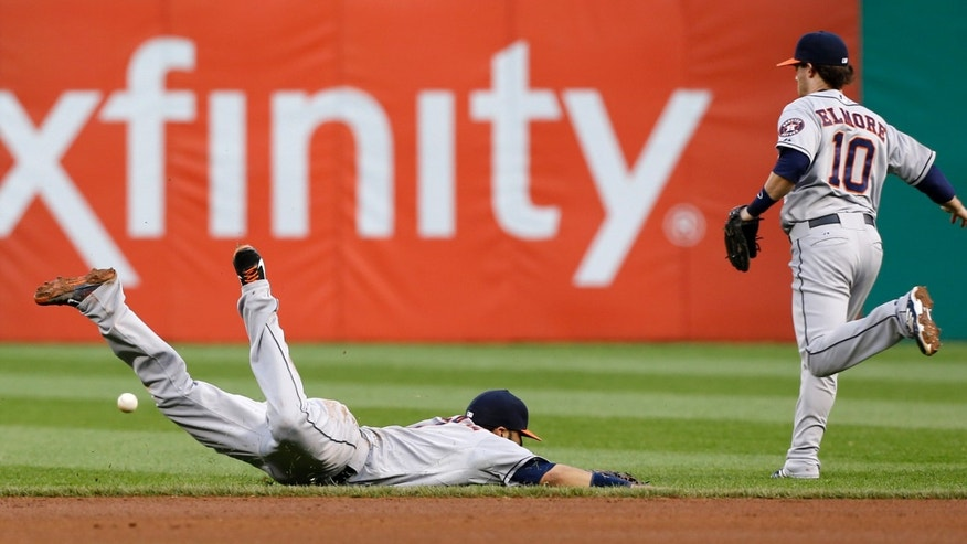 Houston Astros shortstop Marwin Gonzalez, left, dives for a single by Pittsburgh Pirates' Pedro Alvarez as shortstop Jake Elmore (10) pursues in the fourth inning of the baseball game on Friday, May 17, 2013, in Pittsburgh. (AP Photo/Keith Srakocic)