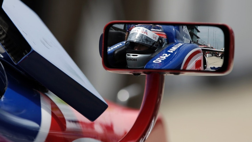 Takuma Sato, of Japan, is reflected in the mirror of his car during a break in practice for the Indianapolis 500 auto race at the Indianapolis Motor Speedway in Indianapolis, Thursday, May 16, 2013. (AP Photo/Darron Cummings)