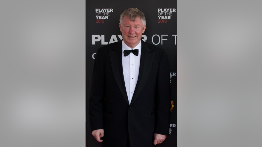 Manchester United's manager Alex Ferguson arrives for the team's Player of the Year Awards dinner at Old Trafford Stadium, Manchester, England, Wednesday May 15, 2013. (AP Photo/Jon Super)