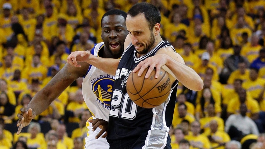 San Antonio Spurs Manu Ginobili drives past Golden State Warriors Draymond Green in Game 6 of a Western Conference semifinal NBA basketball playoff series in Oakland, Calif., May 16, 2013.