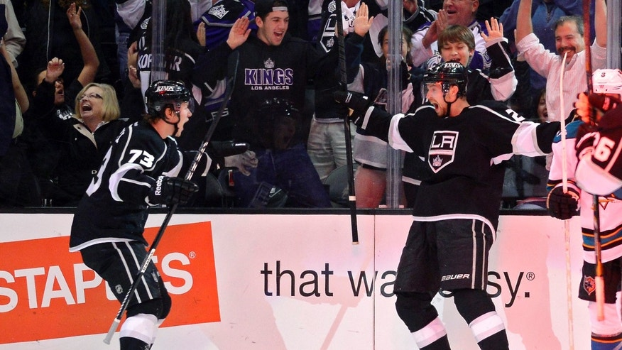 Los Angeles Kings center Trevor Lewis, right, celebrates his goal with center Tyler Toffoli during the third period in Game 2 of their second-round NHL hockey Stanley Cup playoff series against the San Jose Sharks, Thursday, May 16, 2013, in Los Angeles.  (AP Photo/Mark J. Terrill)