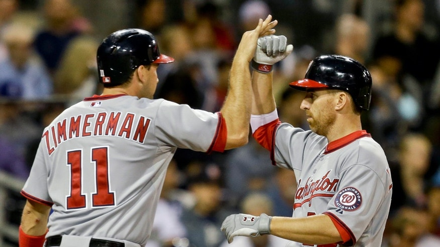 Washington Nationals' Adam LaRoche, right, is congratulated by Ryan Zimmerman after hitting a two-run home run against the San Diego Padres in the fourth inning of a baseball game in San Diego, Thursday, May 16, 2013. (AP Photo/Lenny Ignelzi)