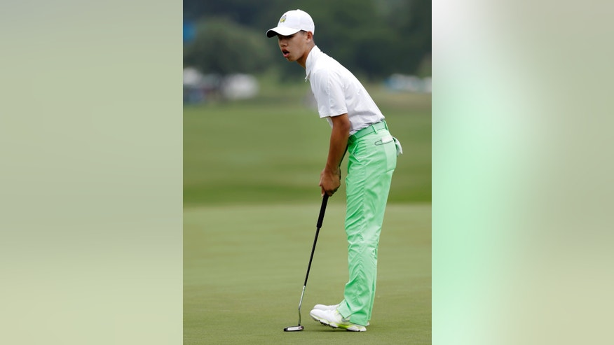 Amateur Guan Tianglang, 14, of China, reacts to missing a putt for par on the 16th green during the second round of the Byron Nelson Championship golf tournament Friday, May 17, 2013, in Irving, Texas. He bogeyed the hole. (AP Photo/Tony Gutierrez)