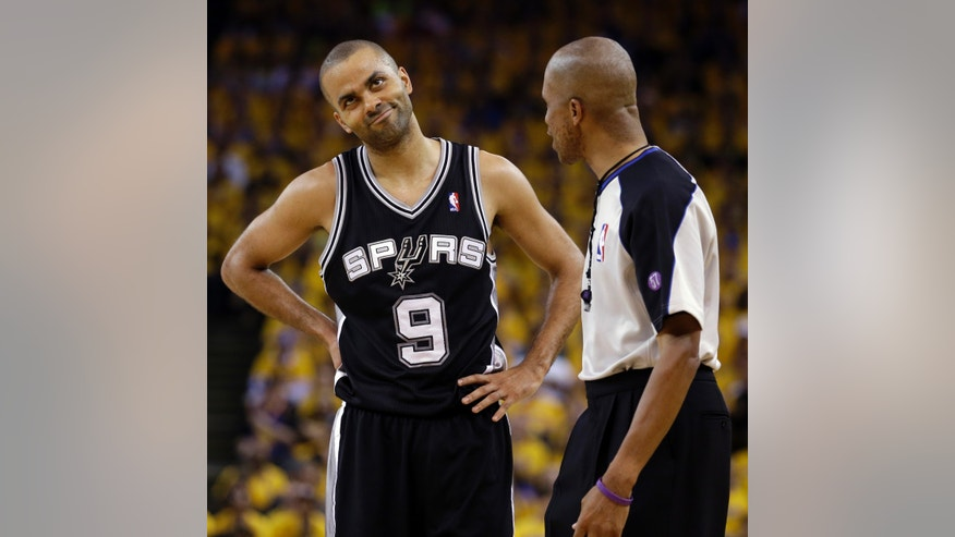 San Antonio Spurs point guard Tony Parker (9) reacts to a call from referee Zach Zarba (33) in the second quarter against the Golden State Warriors in Game 6 of a Western Conference semifinal NBA basketball playoff series in Oakland, Calif., Thursday, May 16, 2013. (AP Photo/Jeff Chiu)
