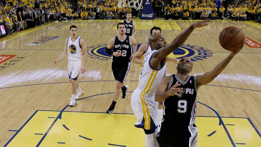 San Antonio Spurs' Tony Parker (9), of France, shoots next to Golden State Warriors' Jarrett Jack, center, during the second half of Game 6 of a Western Conference semifinal NBA basketball playoff series in Oakland, Calif., Thursday, May 16, 2013. (AP Photo/Marcio Jose Sanchez)