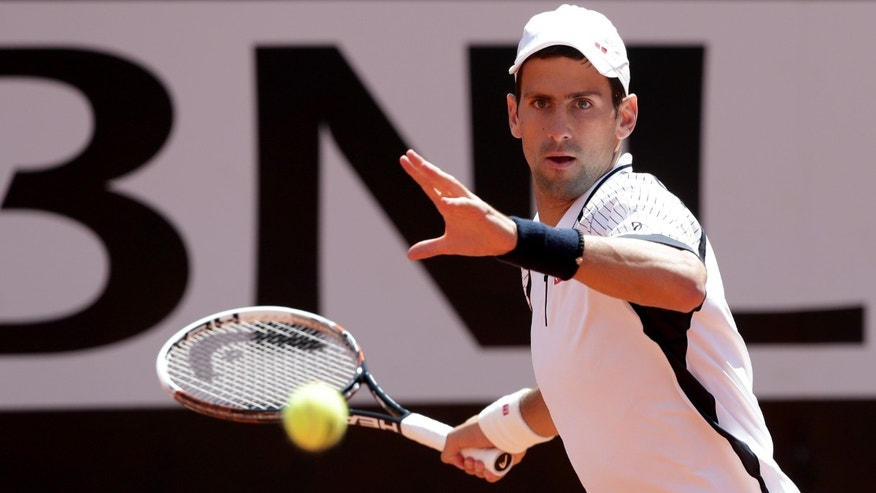 Serbia's Novak Djokovic returns the ball to Czech Republic's Tomas Berdych during their match at the Italian Open tennis tournament in Rome, Friday, May 17, 2013. (AP Photo/Riccardo De Luca)