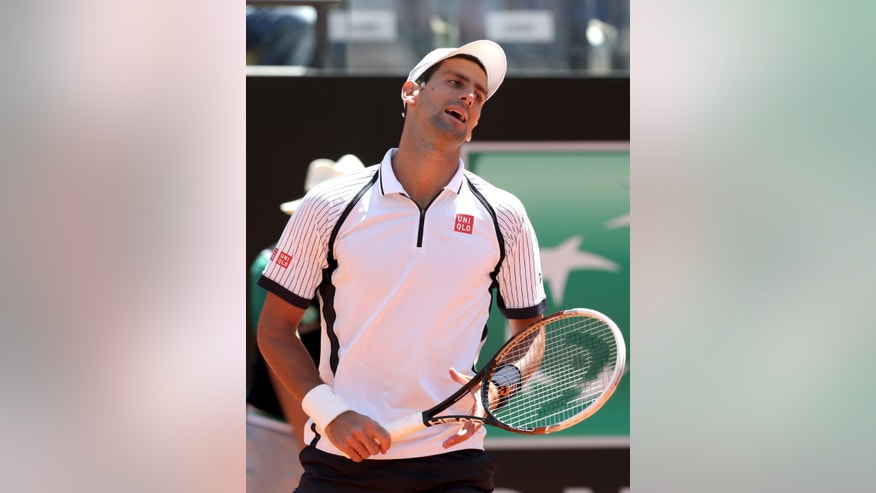 Serbia's Novak Djokovic reacts after missing a point against Czech Republic's Tomas Berdych during their match at the Italian Open tennis tournament in Rome, Friday, May 17, 2013. (AP Photo/Riccardo De Luca)