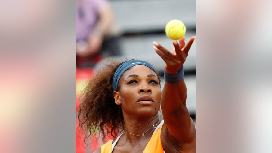 Serena Williams, of the United States, serves the ball to Slovakia's Dominika Cibulkova, during their match at the Italian Open tennis tournament in Rome, Thursday, May 16, 2013. (AP Photo/Riccardo De Luca)