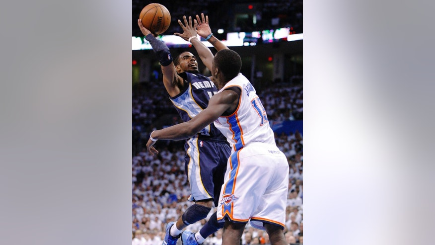 Memphis Grizzlies point guard Mike Conley (11) shoots as Oklahoma City Thunder point guard Reggie Jackson (15) defends defends during the second half of Game 5 of their Western Conference Semifinals NBA basketball playoff series in Oklahoma City, Wednesday, May 15, 2013.  Memphis won 88-84.  (AP Photo/Alonzo Adams)