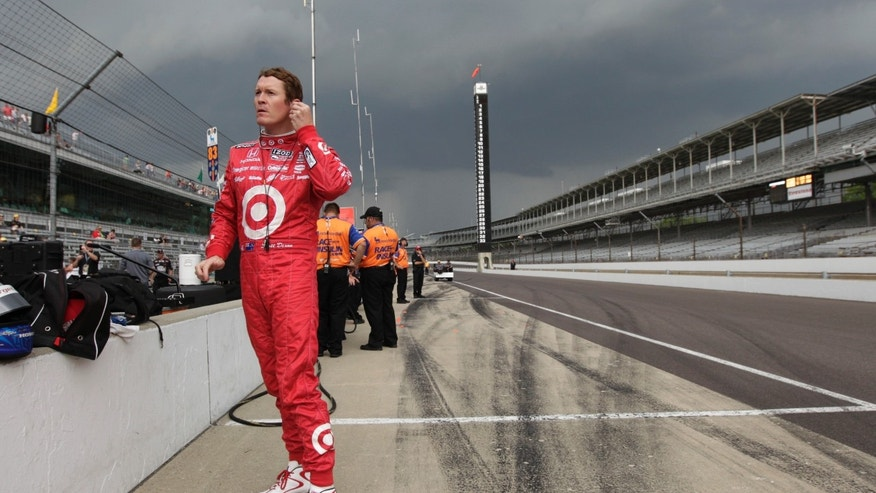 Scott Dixon, of New Zealand, prepares to practice as storm clouds move in that delayed practice for the Indianapolis 500 auto race at the Indianapolis Motor Speedway in Indianapolis, Friday, May 17, 2013. (AP Photo/AJ Mast)