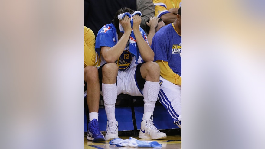 Golden State Warriors center Andrew Bogut sits on the bench during the fourth quarter of Game 6 of a Western Conference semifinal NBA basketball playoff series against the San Antonio Spurs in Oakland, Calif., Thursday, May 16, 2013. The Spurs won 94-82. (AP Photo/Jeff Chiu)