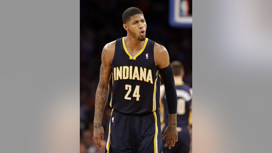 Indiana Pacers' Paul George reacts after scoring against the New York Knicks in the second half of Game 5 of an Eastern Conference semifinal in the NBA basketball playoffs, at Madison Square Garden in New York, Thursday, May 16, 2013. (AP Photo/Julio Cortez)