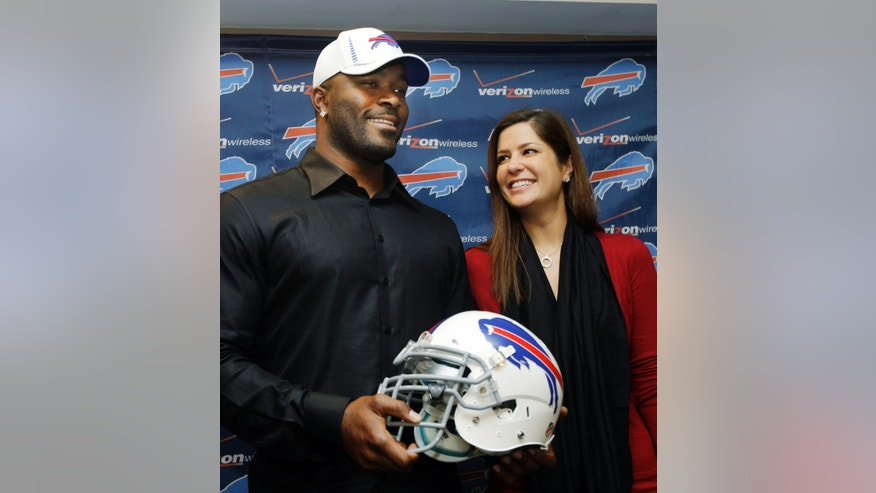 "FILE - In this March 15, 2012 photo, Buffalo Bills' Mario Williams poses for a photo with his fiancee Erin Marzouki smile after an NFL football news conference in Orchard Park, N.Y. Here's one thing that can happen when love goes bad: Bills defensive end Mario Williams is suing his ex-fiancee, demanding she return a $785,000 diamond engagement ring. In response, Marzouki has filed a countersuit, calling Williams' demands ""ridiculous."" (AP Photo/David Duprey, File)"