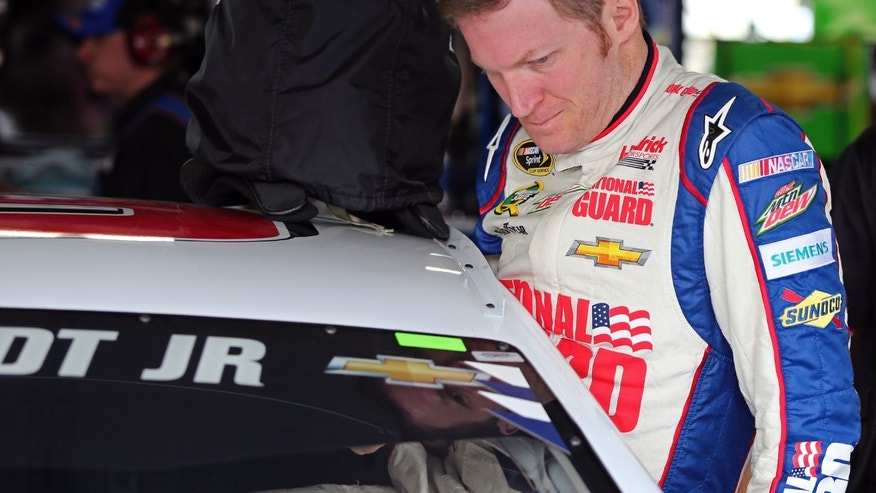 Dale Earnhardt Jr. climbs into his car for practice for the NASCAR Sprint All-Star auto race at Charlotte Motor Speedway in Concord, N.C., Friday, May 17, 2013. (AP Photo/Bob Jordan)