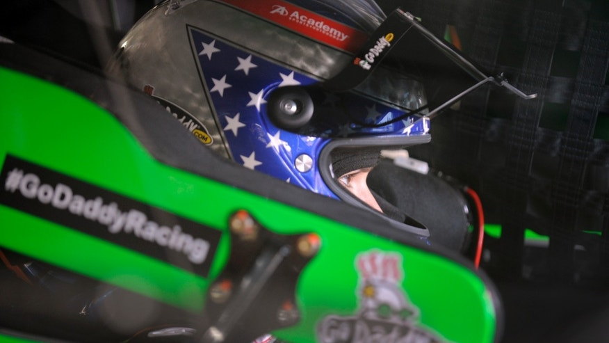 Danica Patrick waits in her race car before practice for the NASCAR Sprint Showdown auto race at Charlotte Motor Speedway in Concord, N.C., Friday, May 17, 2013. (AP Photo/Mike McCarn)