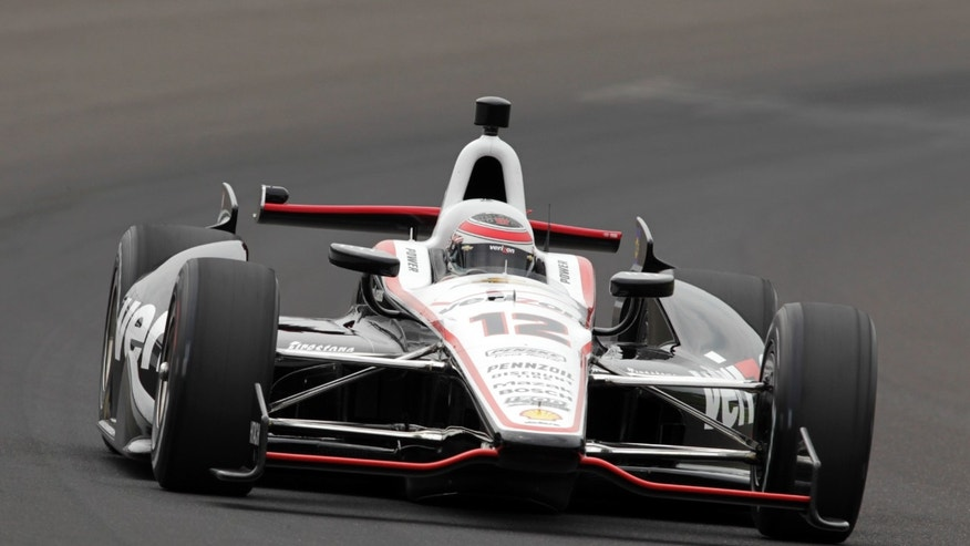 Will Power, of Australia, drives through the first turn on his qualification run on the first day of qualifications for the Indianapolis 500 auto race at Indianapolis Motor Speedway in Indianapolis, Saturday, May 18, 2013. (AP Photo/AJ Mast)