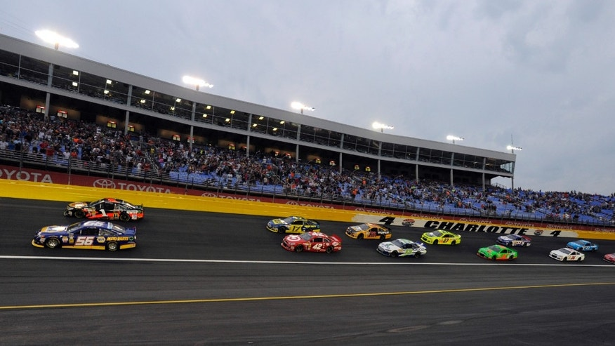 Jamie McMurray (1) and Martin Truex Jr (56) lead the field at the start of the NASCAR Sprint Showdown auto race at Charlotte Motor Speedway in Concord, N.C., Saturday, May 18, 2013. (AP Photo/Mike McCarn)