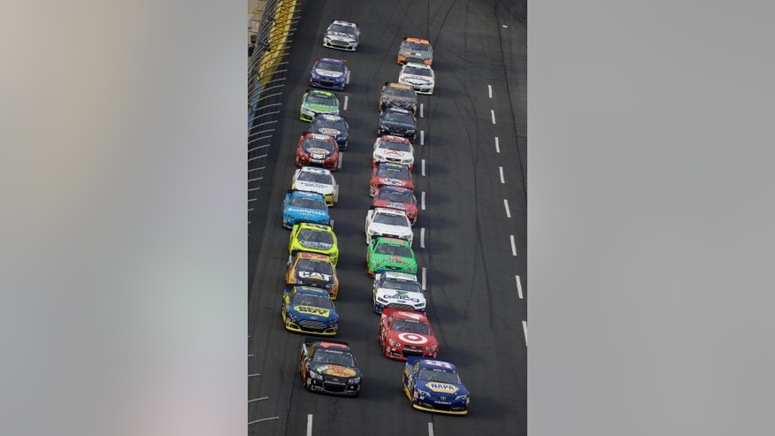 Drivers approach the start line to begin the NASCAR Sprint Cup Series Showdown auto race at Charlotte Motor Speedway in Concord, N.C., Saturday, May 18, 2013. (AP Photo/Gerry Broome)