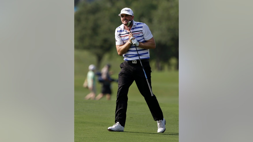 Keegan Bradley watches his shot off the 16th fairway during the second round of the Byron Nelson Championship golf tournament on Friday, May 17, 2013, in Irving, Texas. (AP Photo/Tony Gutierrez)