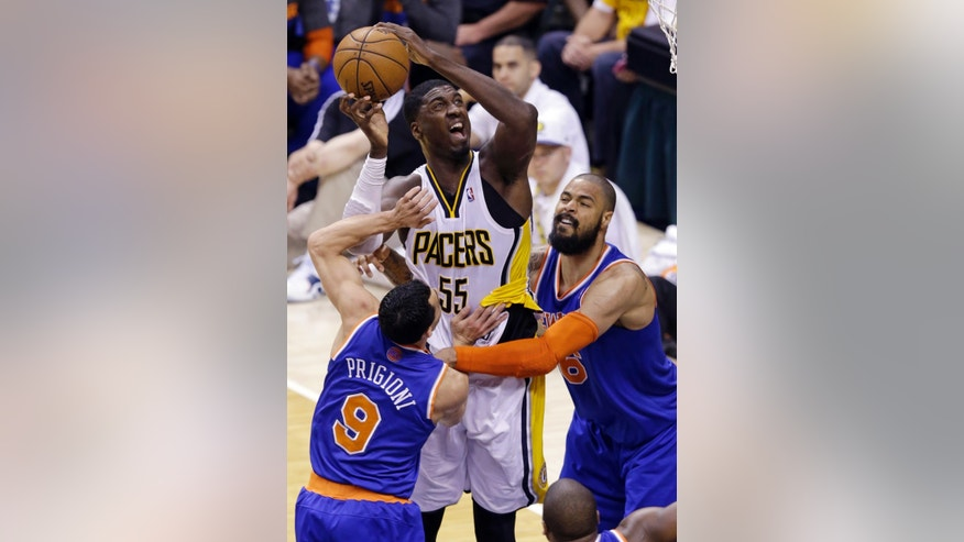 Indiana Pacers center Roy Hibbert (55) is fouled by New York Knicks center Tyson Chandler, right, as he shoots in front of Knicks guard Pablo Prigioni during the third quarter of Game 6 of the Eastern Conference semifinal NBA basketball playoff series in Indianapolis, Saturday, May 18, 2013. (AP Photo/Michael Conroy)