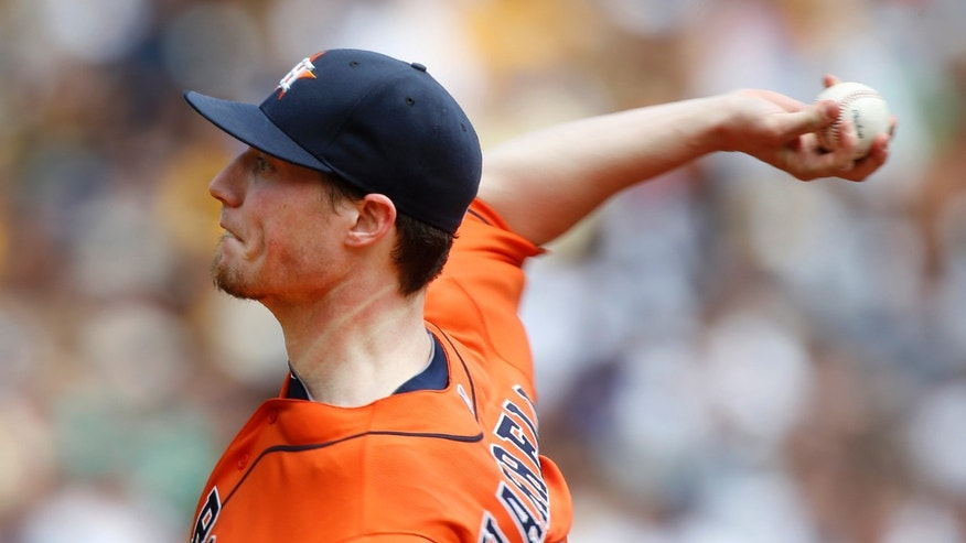 Houston Astros starting pitcher Lucas Harrell throws against the Pittsburgh Pirates in the first inning of the baseball game on Sunday, May 19, 2013, in Pittsburgh. (AP Photo/Keith Srakocic)