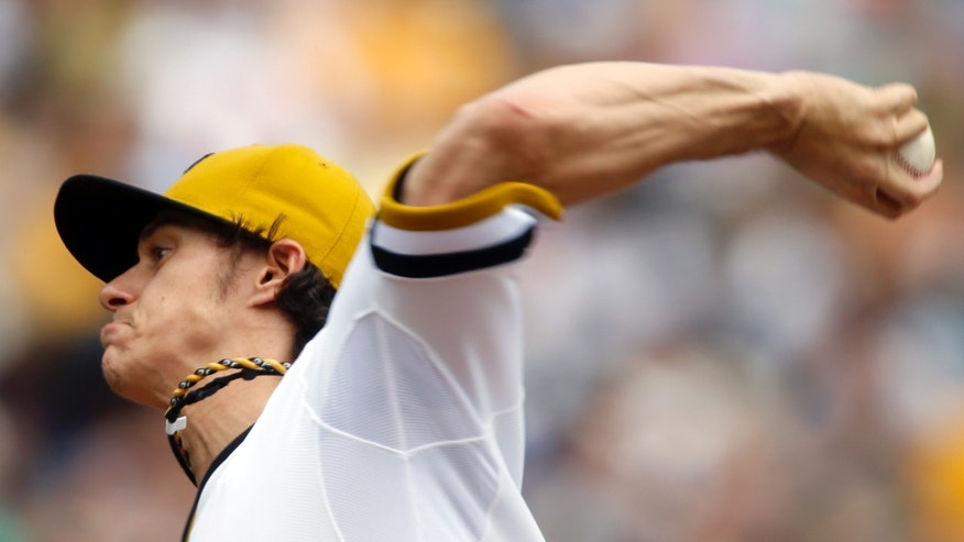 Pittsburgh Pirates starting pitcher Jeff Locke throws against the Houston Astros in the first inning of the baseball game on Sunday, May 19, 2013, in Pittsburgh. (AP Photo/Keith Srakocic)