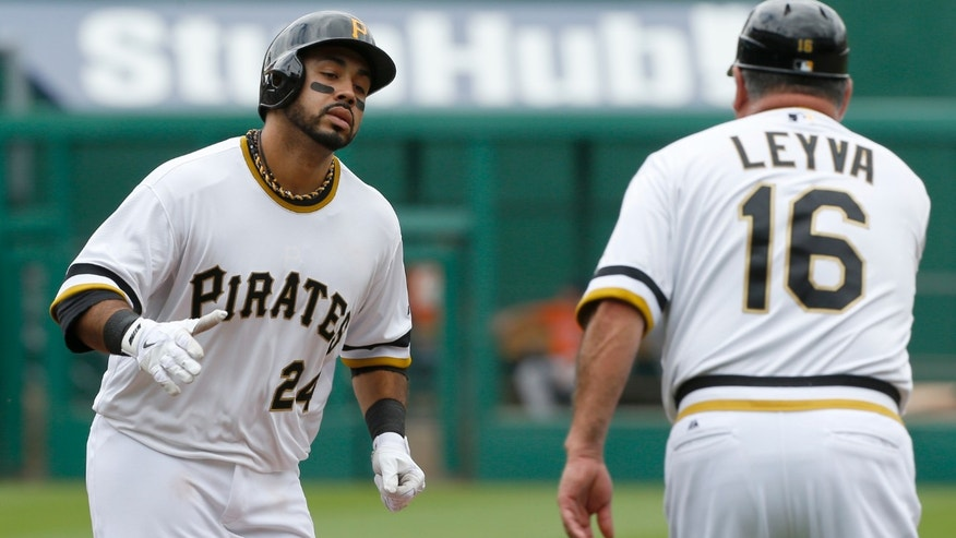 Pittsburgh Pirates' Pedro Alvarez (24) is greeted by Pittsburgh Pirates third base coach Nick Leyva (16) after hitting a home run in the fifth inning of the MLB baseball game against the Houston Astros on Sunday, May  19, 2013, in Pittsburgh. (AP Photo/Keith Srakocic)