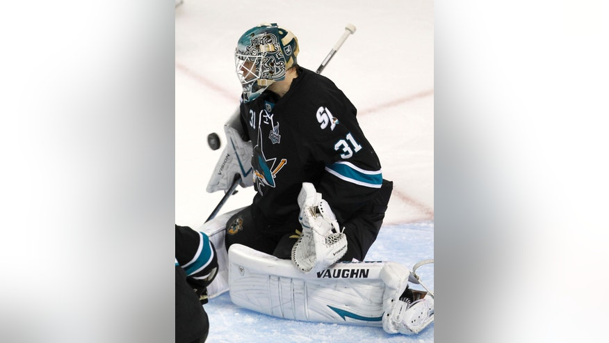 San Jose Sharks goalie Antti Niemi (31), of Finland, blocks a goal attempt against Los Angeles Kings during the second period in Game 3 of their second-round NHL hockey Stanley Cup playoff series, Saturday, May 18, 2013, in San Jose, Calif. (AP Photo/Tony Avelar)